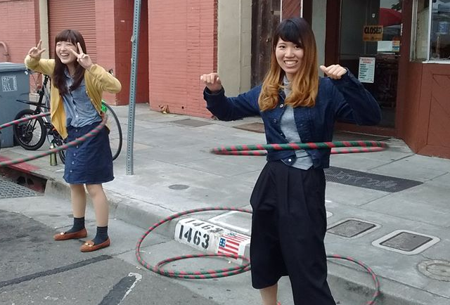 ESI students try the hula hoop at an American street festival